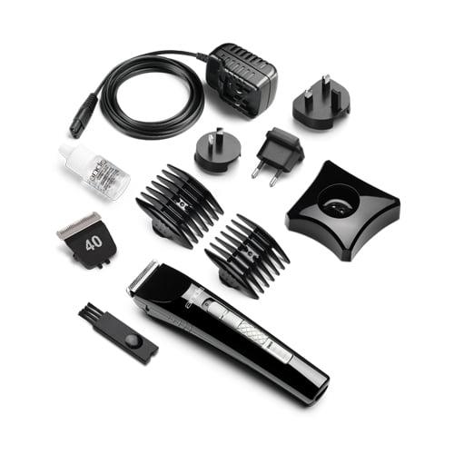 Produktfoto av delene som hører til andis-trimmer